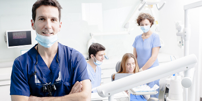 dentists assisting a patient